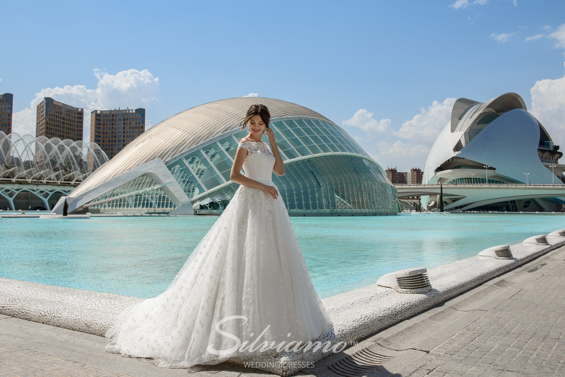 Lush lace wedding dress with a train from Silviamo-1