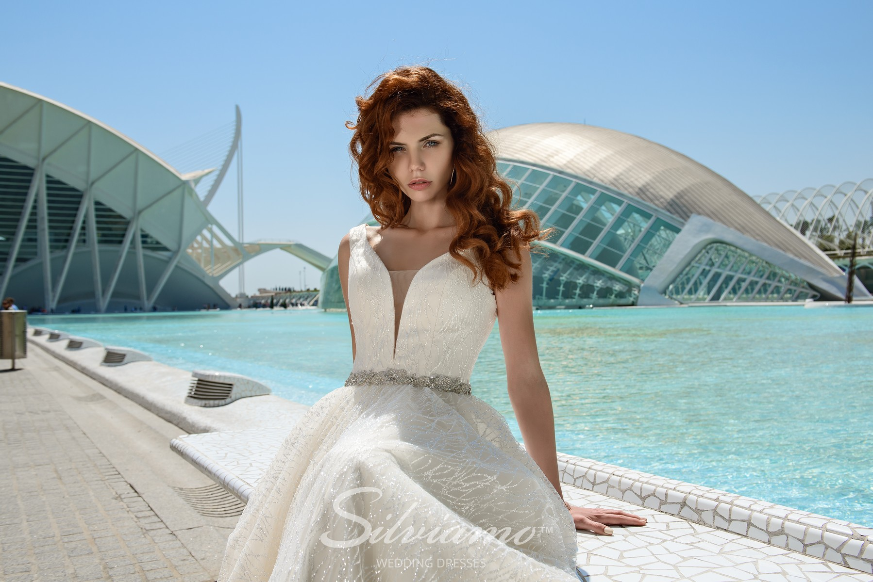 Wedding dress from the shimmer checkered fabric with a divided corset and a train from Silviamo-1