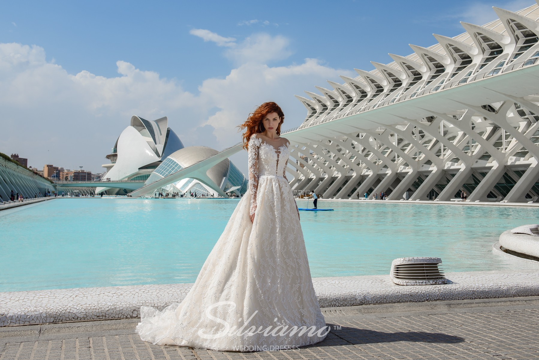 Lace wedding dress with train and long sleeves from Silviamo-1
