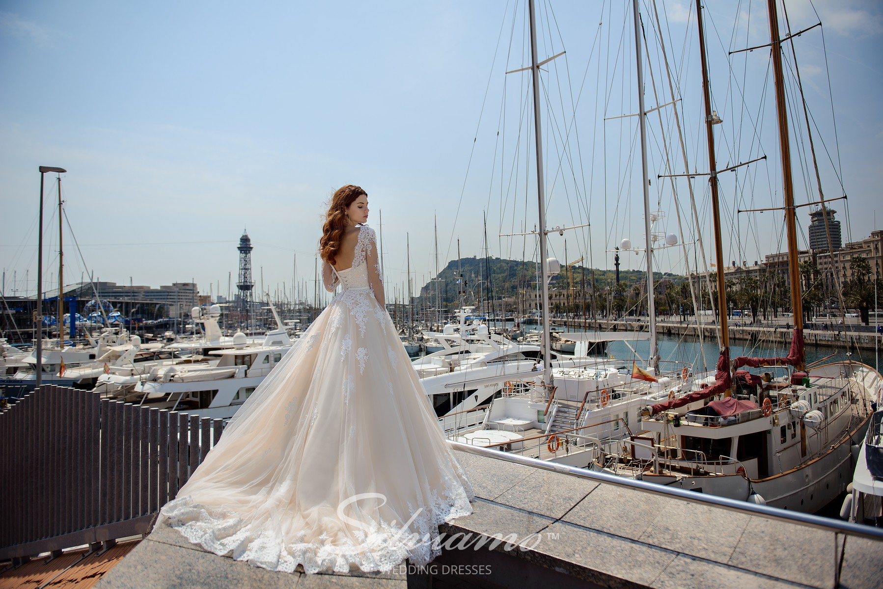 A delicate lace wedding dress on a yoke from Silviamo-1