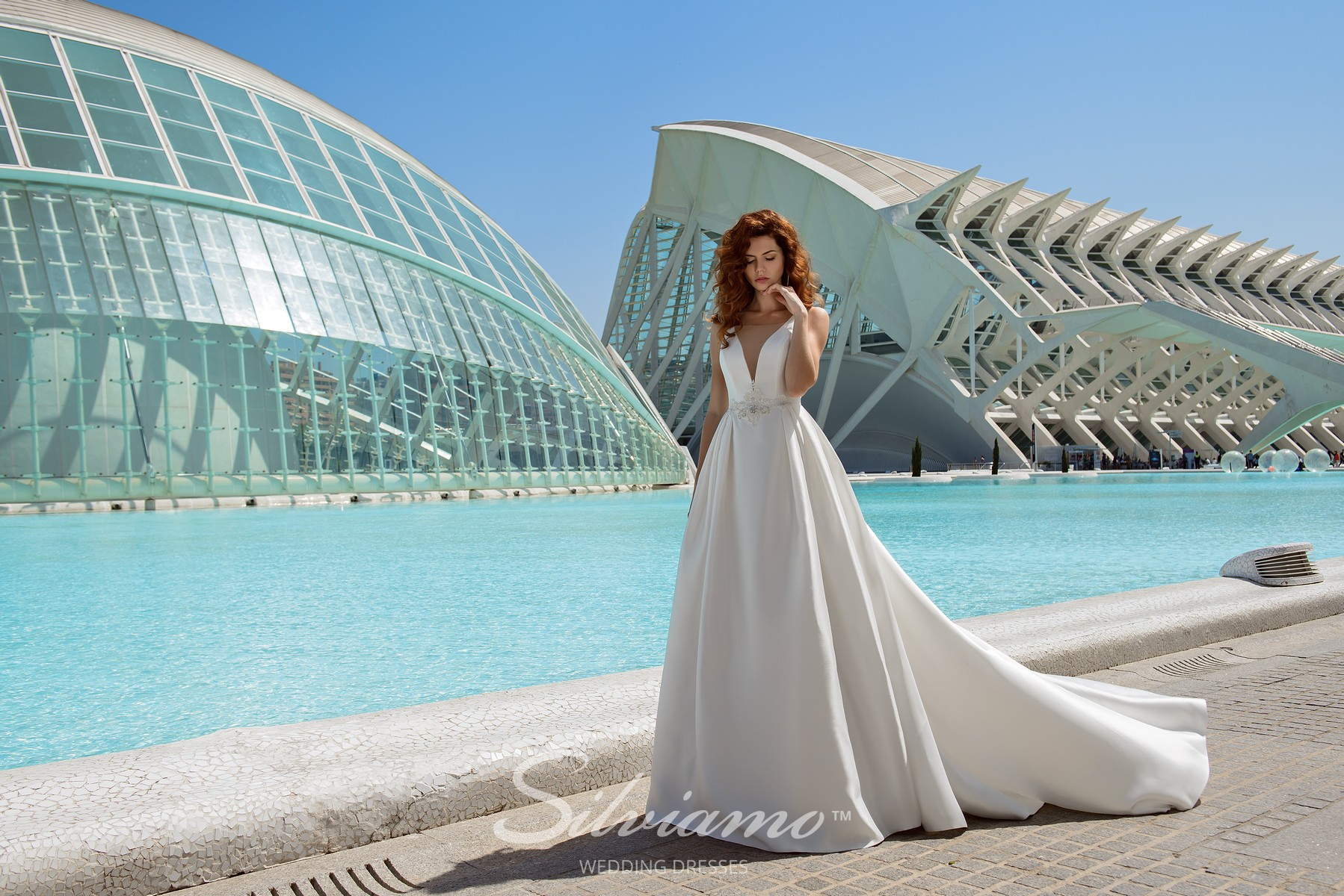 A white dress with a skirt with folds and train from Silviamo brand-1