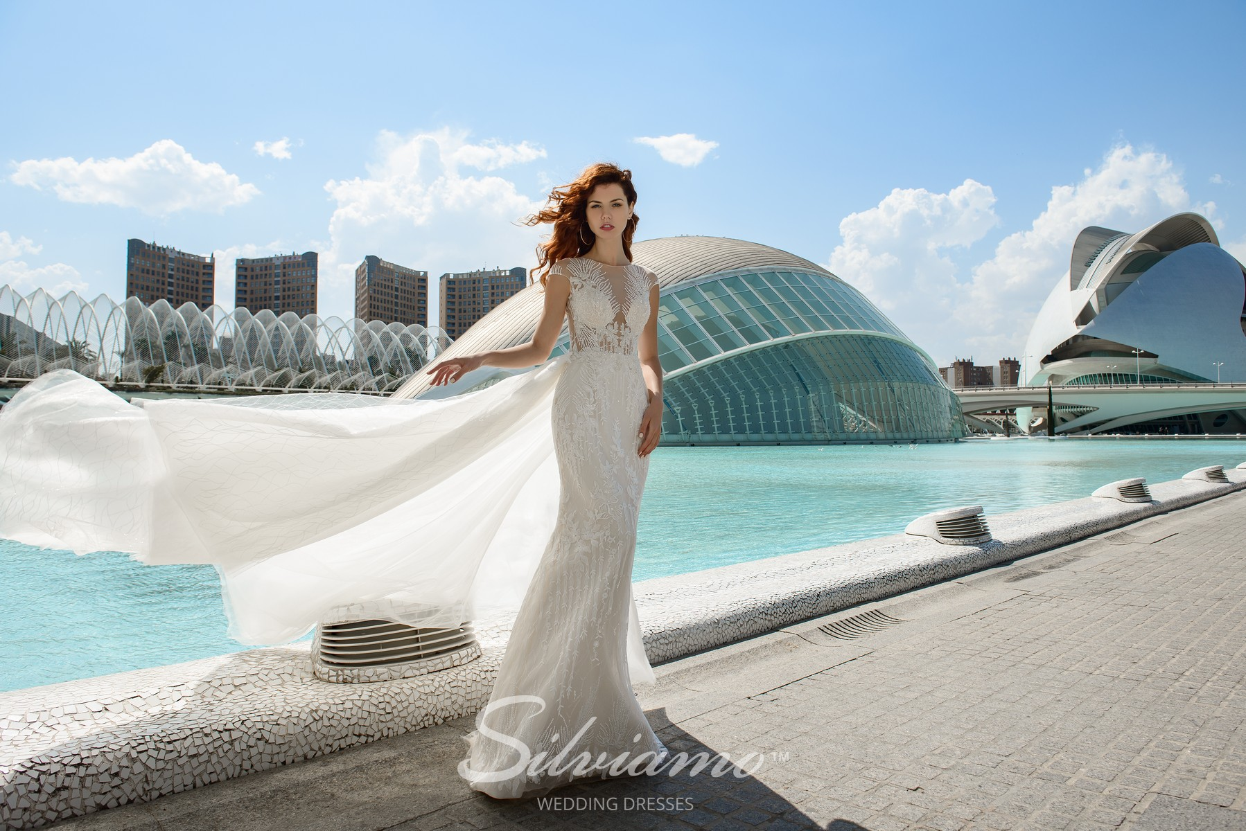 A wedding set of  a godet silhouette dress with a removable train from the  Silviamo brand-1