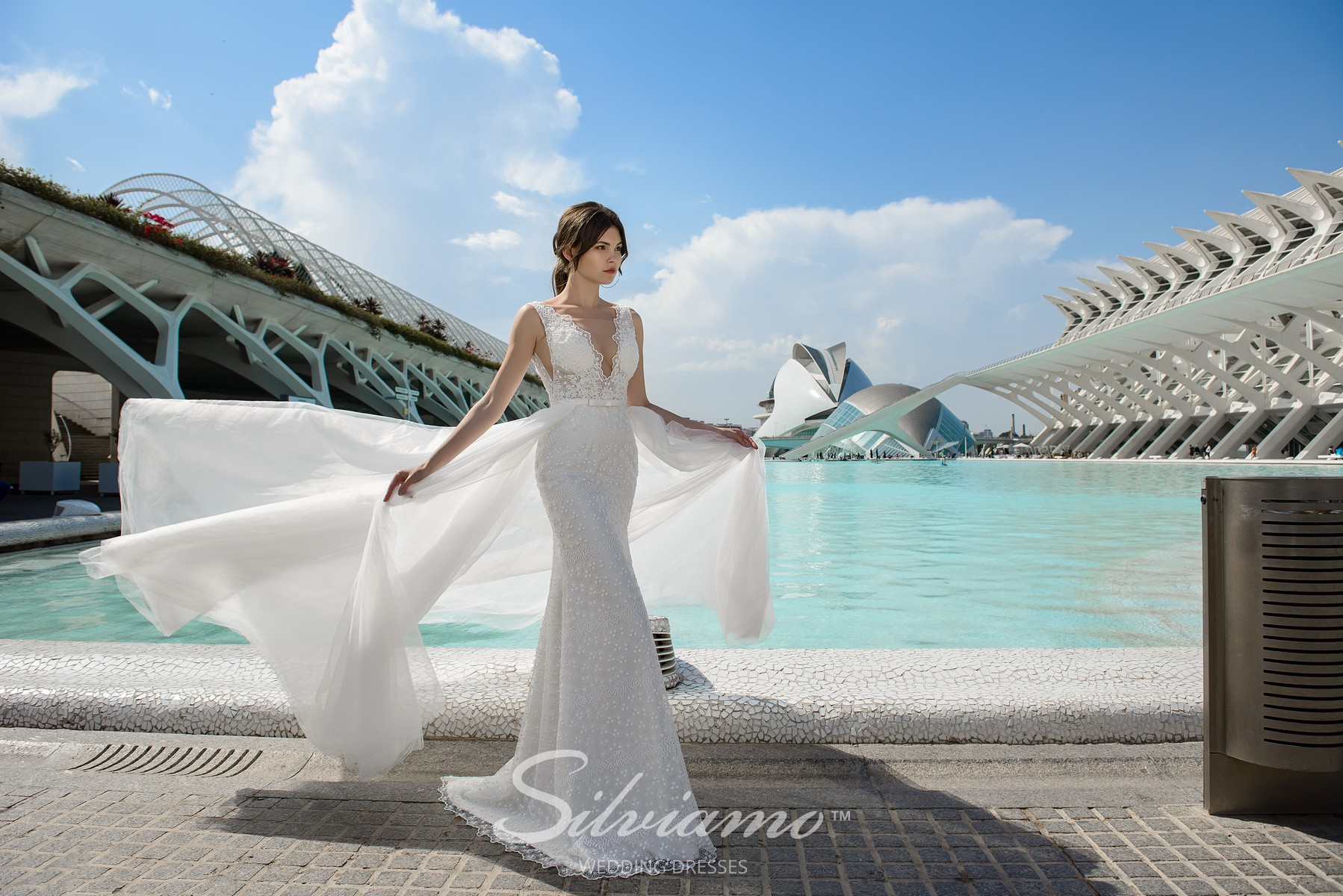 Delicate close- fitting wedding dress with a removable train from Silviamo-1