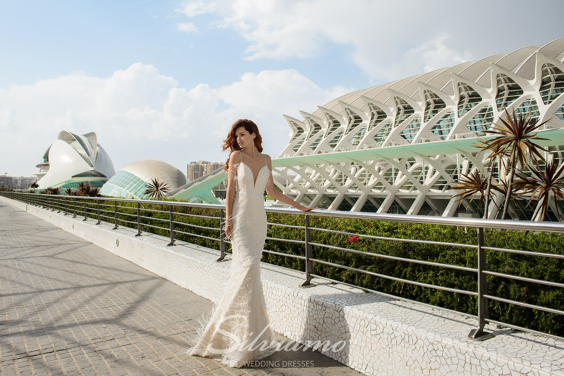 Wedding dresses of godet silhouette decorated with feathers on wholesale from Silviamo.-1