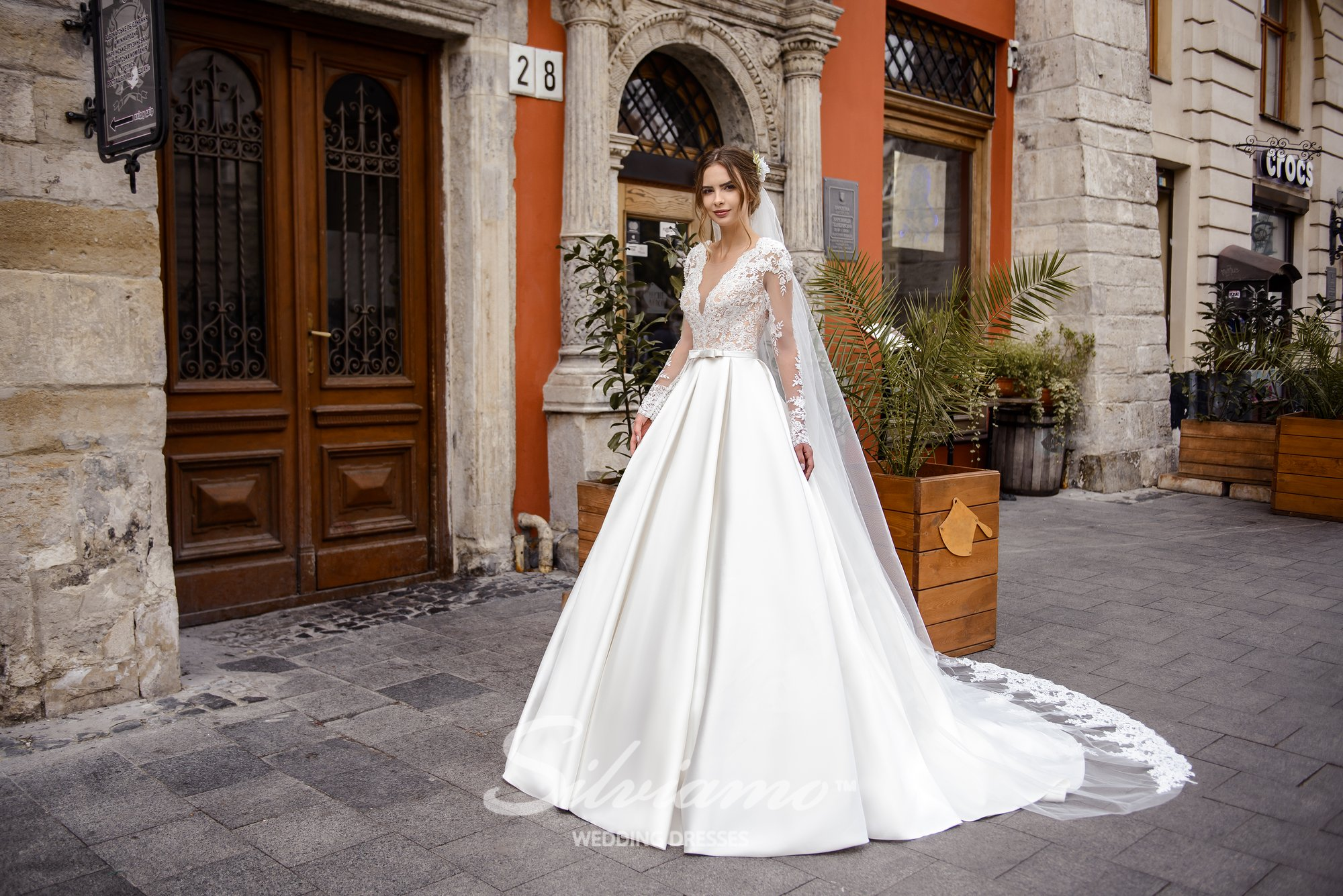 Wedding dress with the folded skirt and the guipure top on wholesale by Silviamo-1