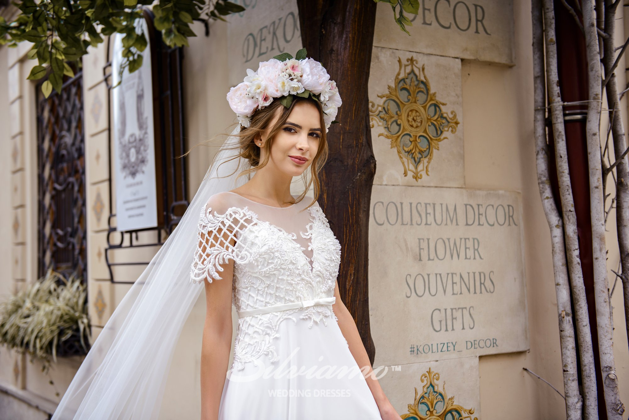 Wedding dress with wings-shaped sleeves on wholesale by Silviamo-1