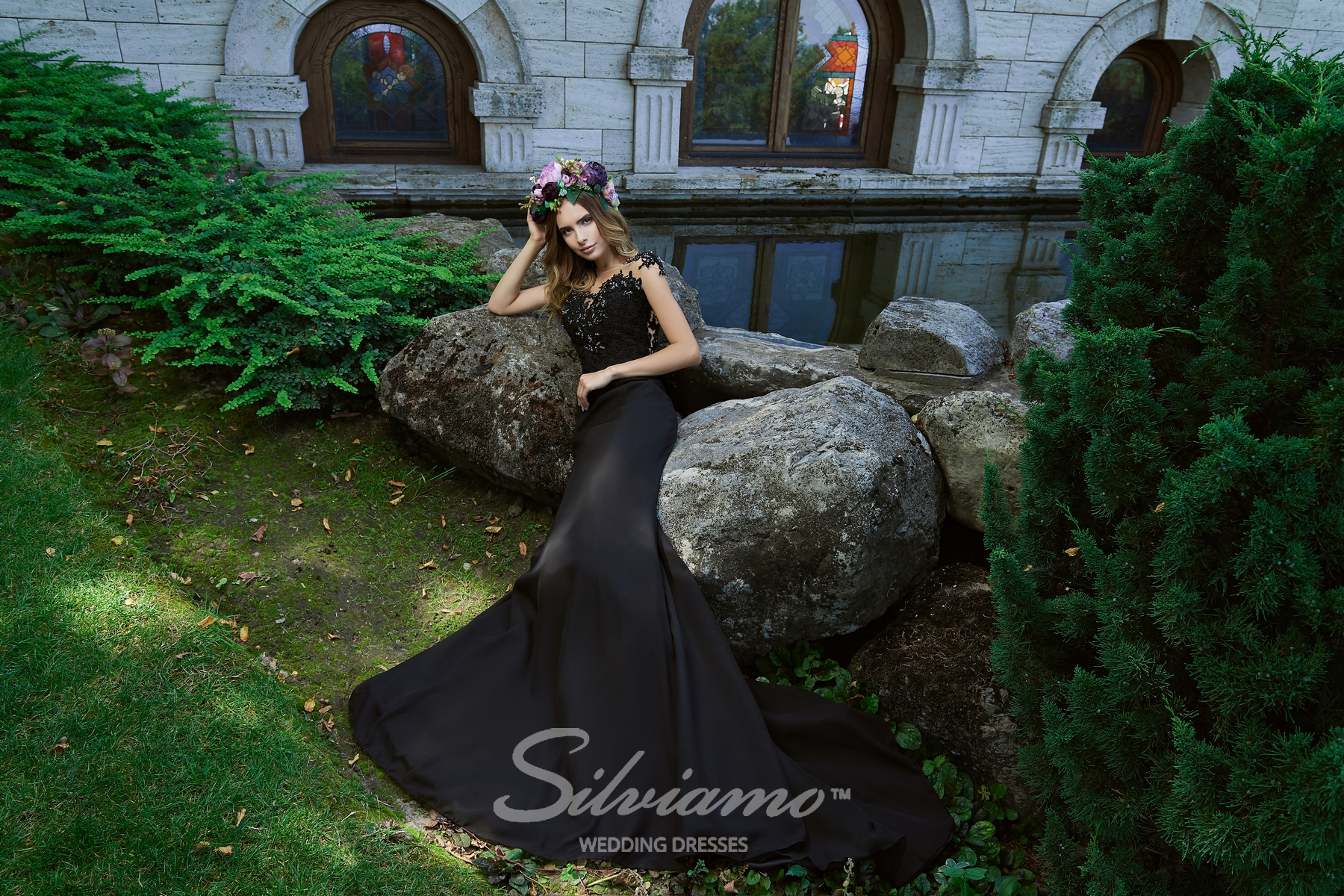 A сlose-fitting chiffon evening dress with embroidered top on wholesale from Silviamo.-1