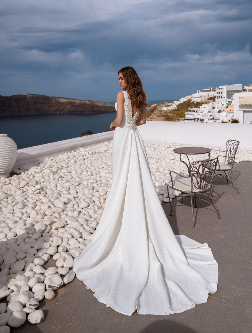 Wedding dress with the decor on the back from TM Silviamo at wholesale price-4