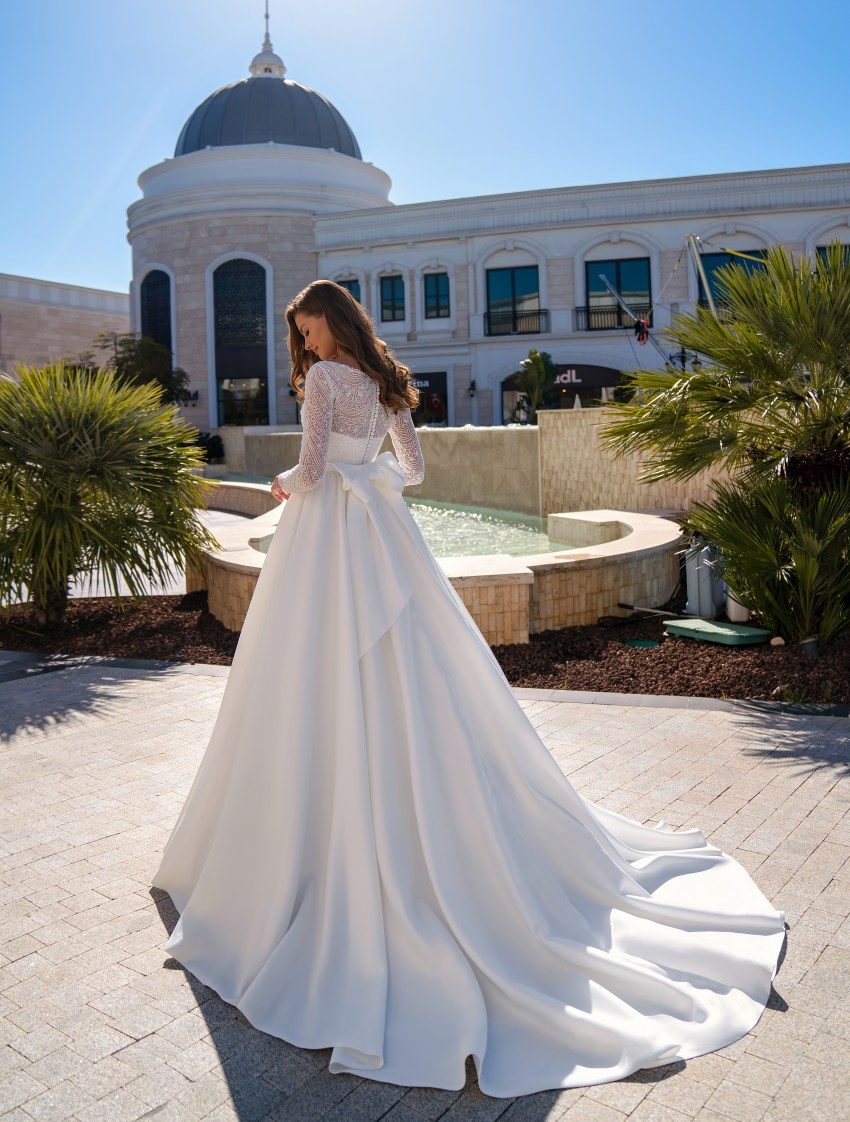 Stunning wedding dress with long sleeves and puffy skirt with a train-4