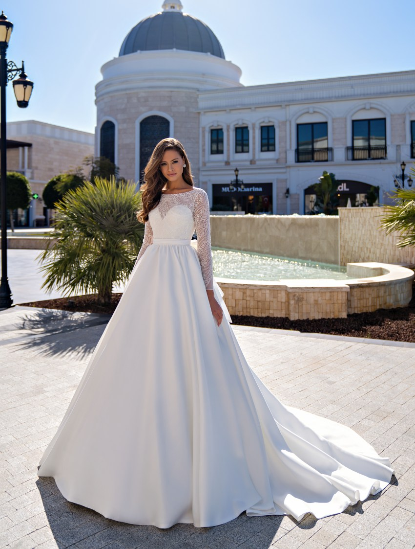 Stunning wedding dress with long sleeves and puffy skirt with a train-2