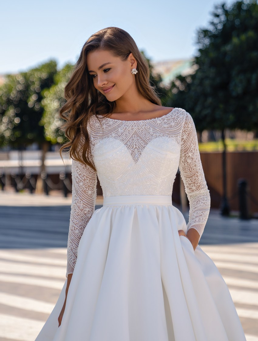 Stunning wedding dress with long sleeves and puffy skirt with a train-3