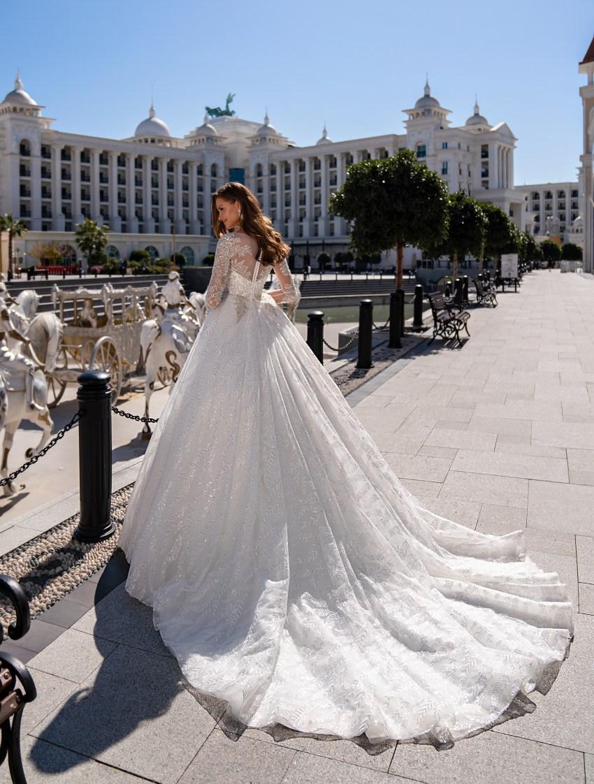 Luxurious long-sleeved wedding dress with a fluffy guipure train skirt-4