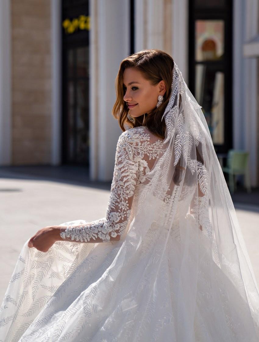 Luxurious long-sleeved wedding dress with a fluffy guipure train skirt-5